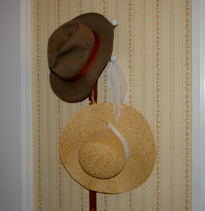 Cyndi's and my hat on the peg by the back door.