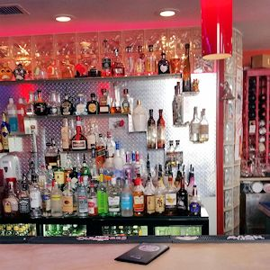 A bar with many bottles