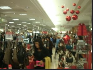 A crowded department store with holiday decorations